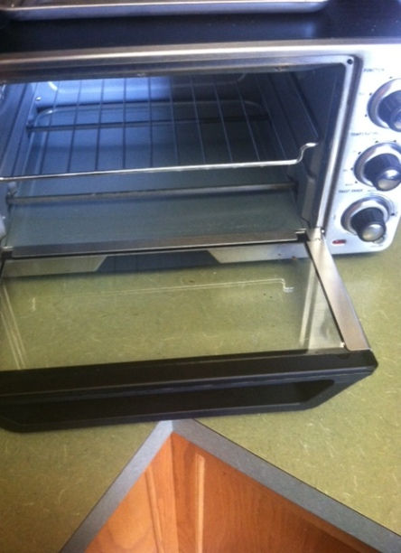 The toaster oven involved in the incident. Notice the unprotected heating element.